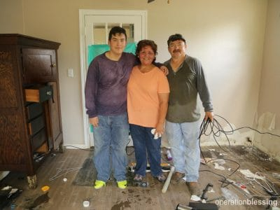Fatima and her family after floodwaters receded.