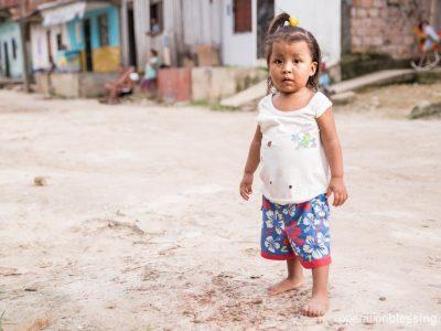 Briyeika stands barefoot.