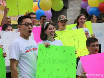 The waters gone, volunteers welcome the family home.