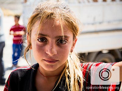 Hungry refugees, like this one, received food and hope.