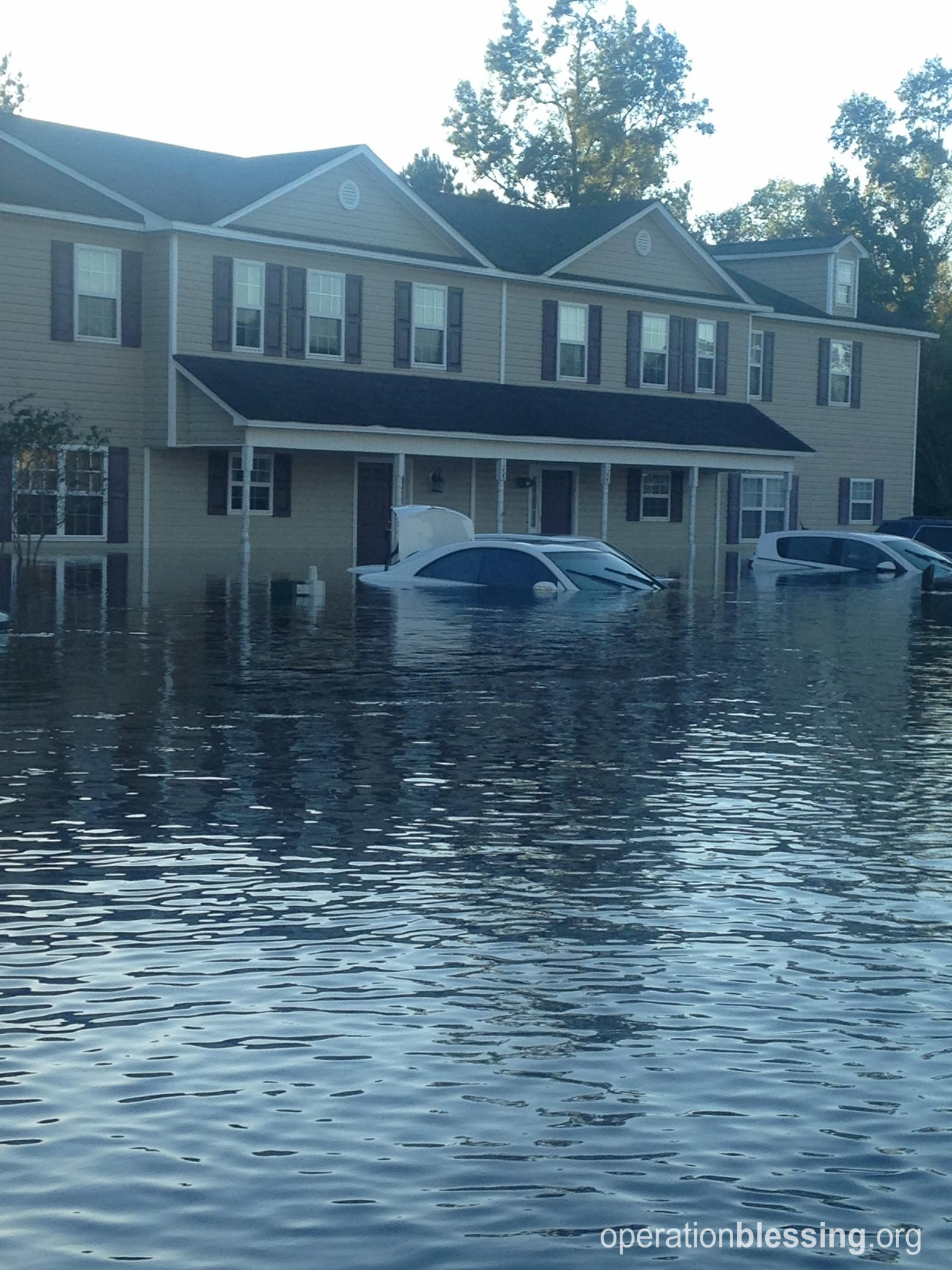 The floodwaters in her neighborhood.