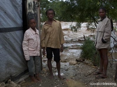 Families like this one suffered damage from Matthew
