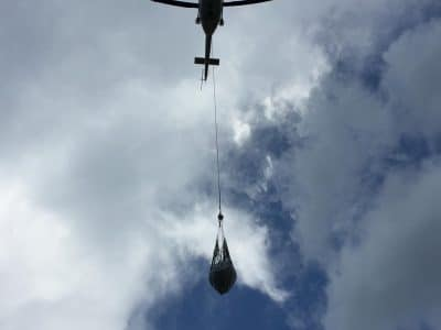 The helicopter hovers with relief for Haiti.