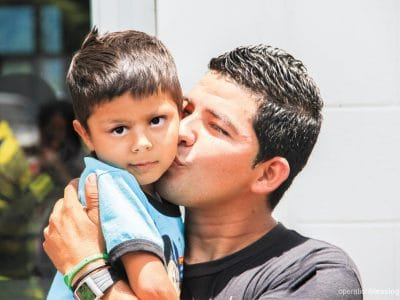 Fito's father kisses him, thankful for his healed heart.