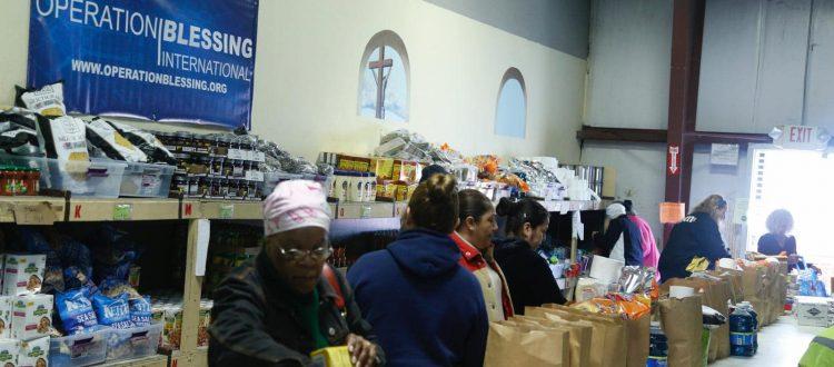 Warehouse of Hope volunteers pack grocery bags.