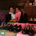 Sonia and Lesly show off the shoe business