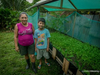 David and Edith stand next to their home garden project.