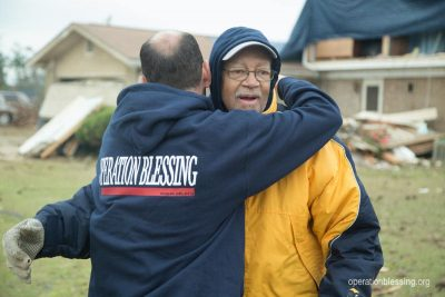 William shares a hug with an Operation Blessing staff member, thankful for the helping hand.