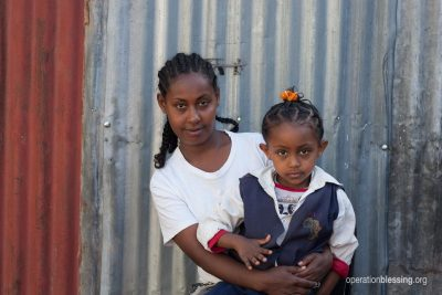 Meseret and her daughter after help from EHE and Operation Blessing.