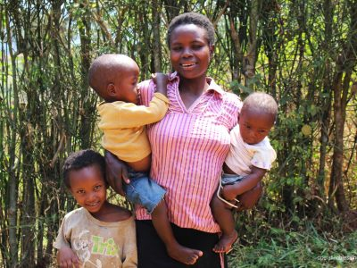Mukashema and her three children in Rwanda.