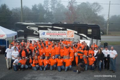 The Home Depot associates join Operation Blessing to help Albany tornado victims.