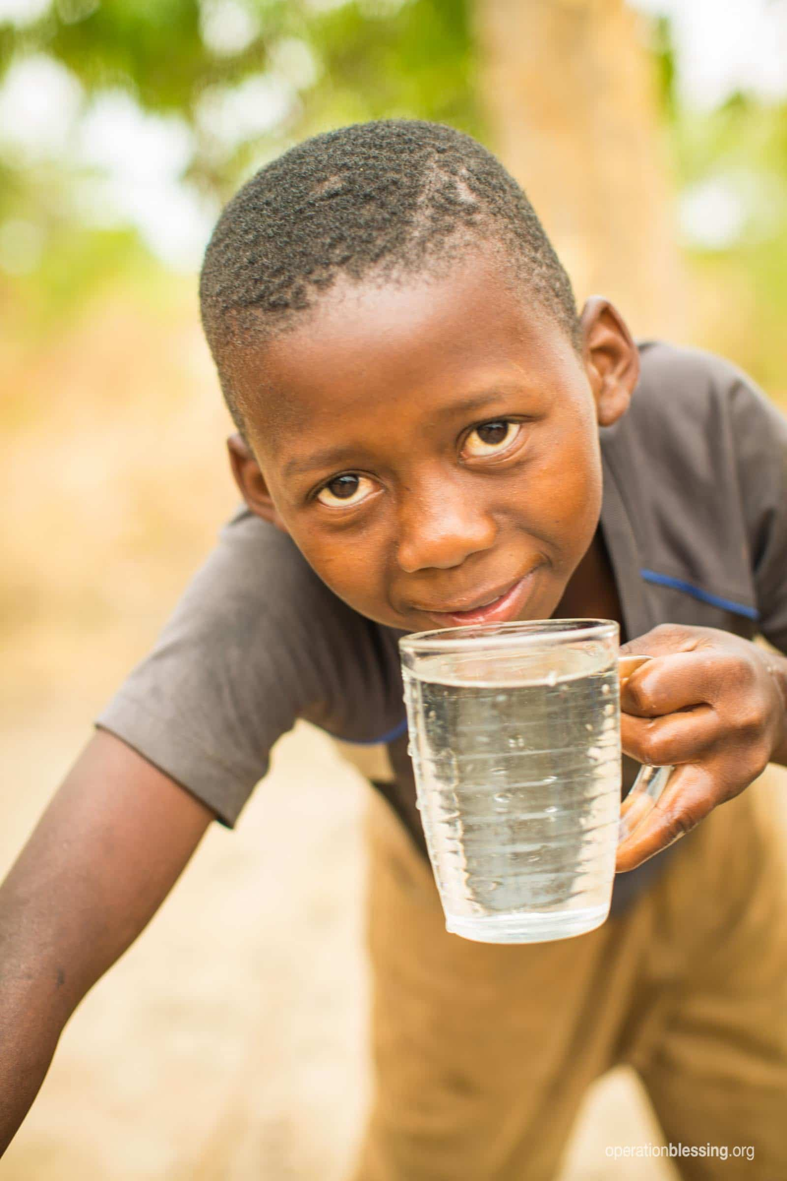 A child drinks safe water.