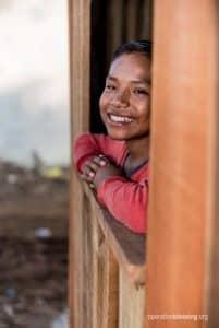 Sergio smiles despite the poverty he has endured.