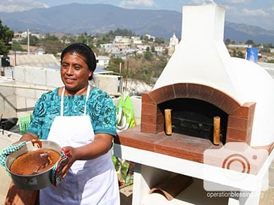 Miriam at her home bakery with her new oven.
