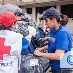 Red Cross and OB Peru team members distribute relief.