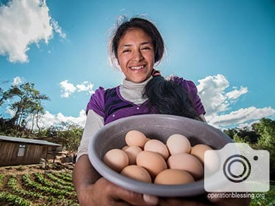 This chicken farm is providing a livelihood for this woman.