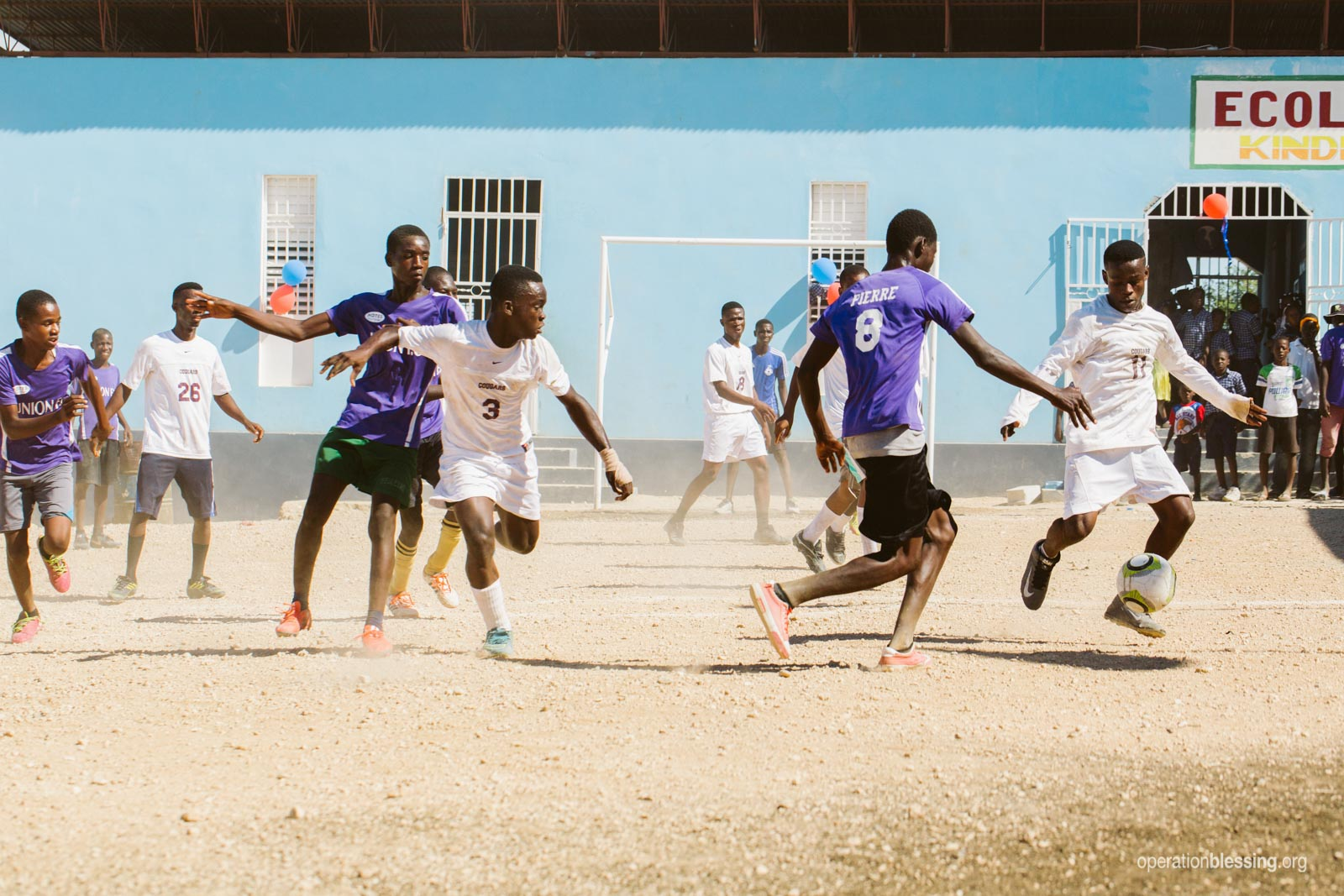 Children enjoy a spirited soccer match at Operation Blessing's Lac Azuei School.