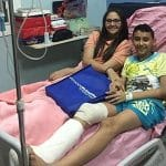 A pair of Palm Sunday attack victims smile from a hospital bed.