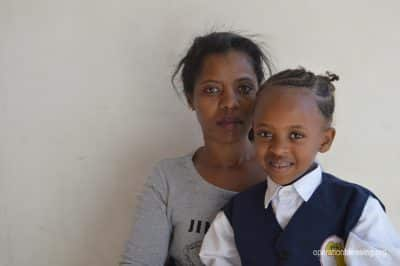Zoe sits with her daughter after embracing hope that changed their lives.