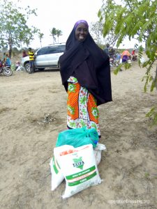 Mujamaa smiles in gratitude for the relief she received.