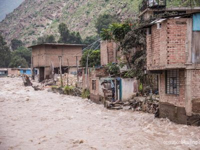 Flooding and mudslides on a street in Peru.