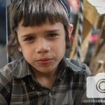 A young boy is thankful for the kosher food his family received for Passover.