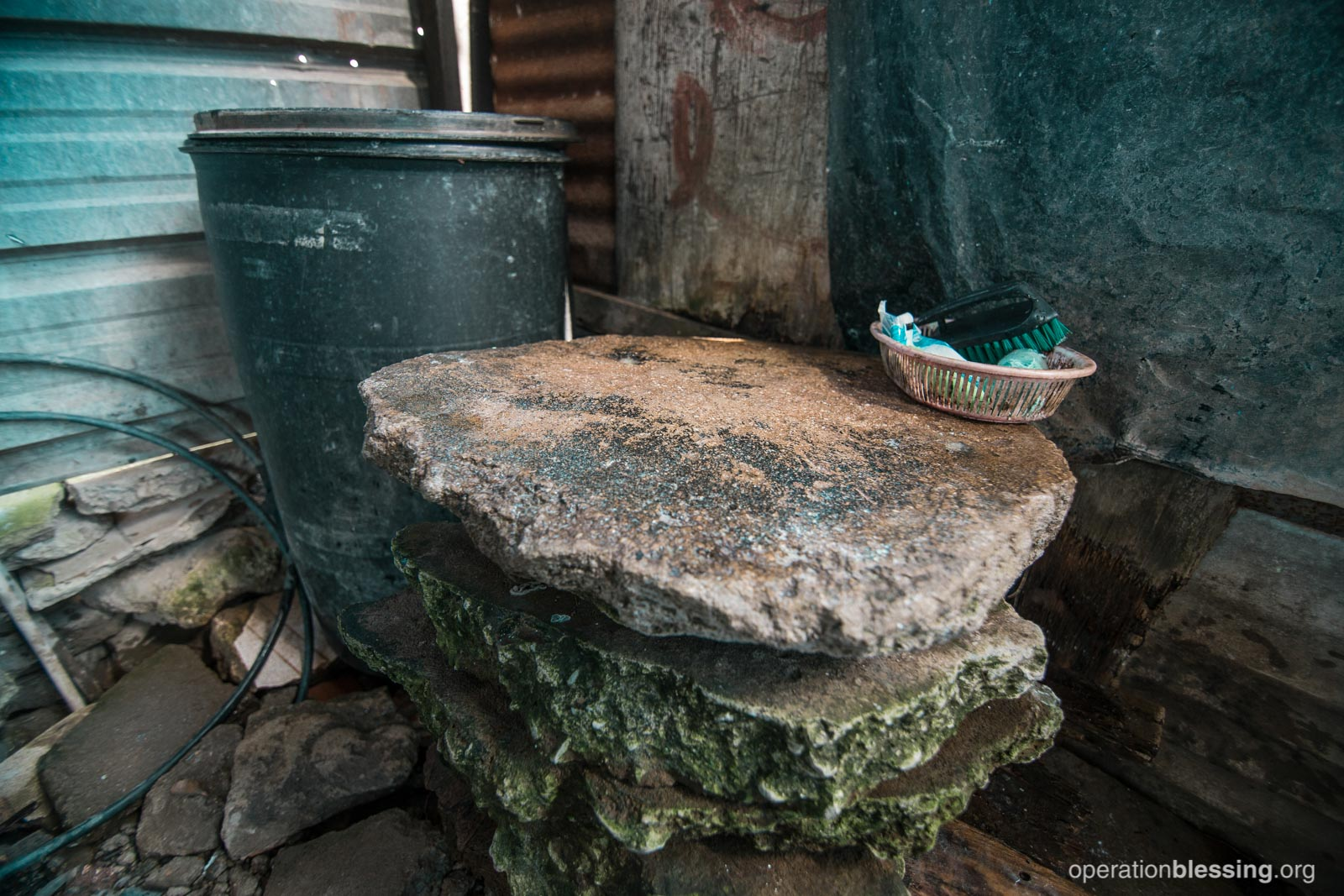 Mercedes used to wash her clothes in this old stone basin, which was a breeding ground for Zika-carrying mosquitoes to grow.