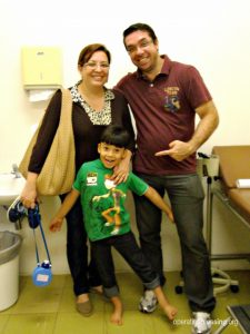 Little Alan smiles gleefully after his care from MiracleFeet and his adoption!