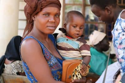 A mother and her child at the South Sudan distribution.