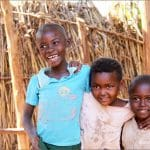 Vestine's children smile, thankful for the legacy their mother has begun.