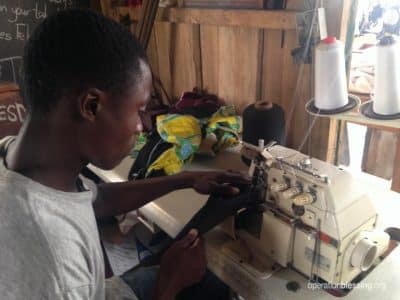Samuel sews cloth and new dreams with his machine.
