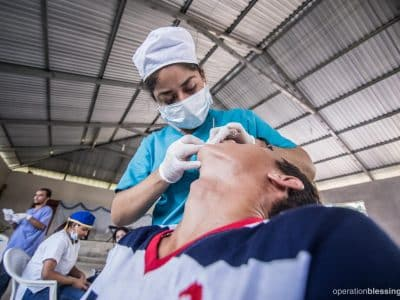 A Honduran man receives dental care at the free medical outreach run by Operation Blessing.