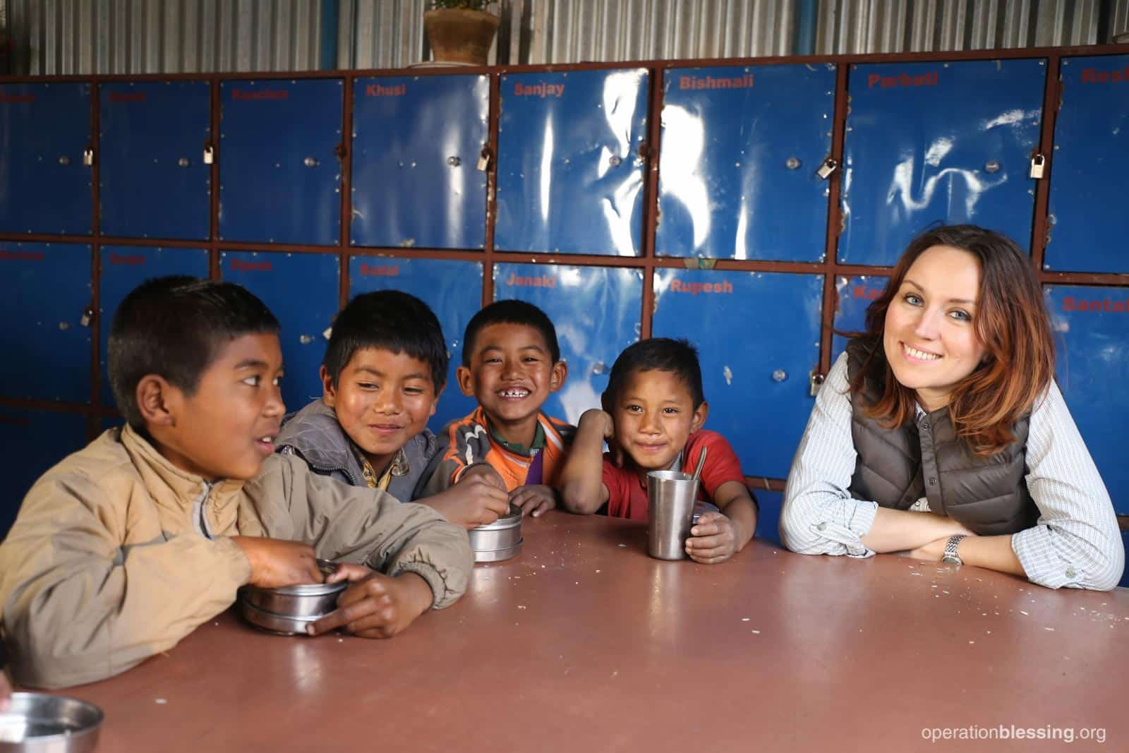 Monica Eriksen, Operation Blessing's livelihood program manager, visits with a group of Nepalese school children.
