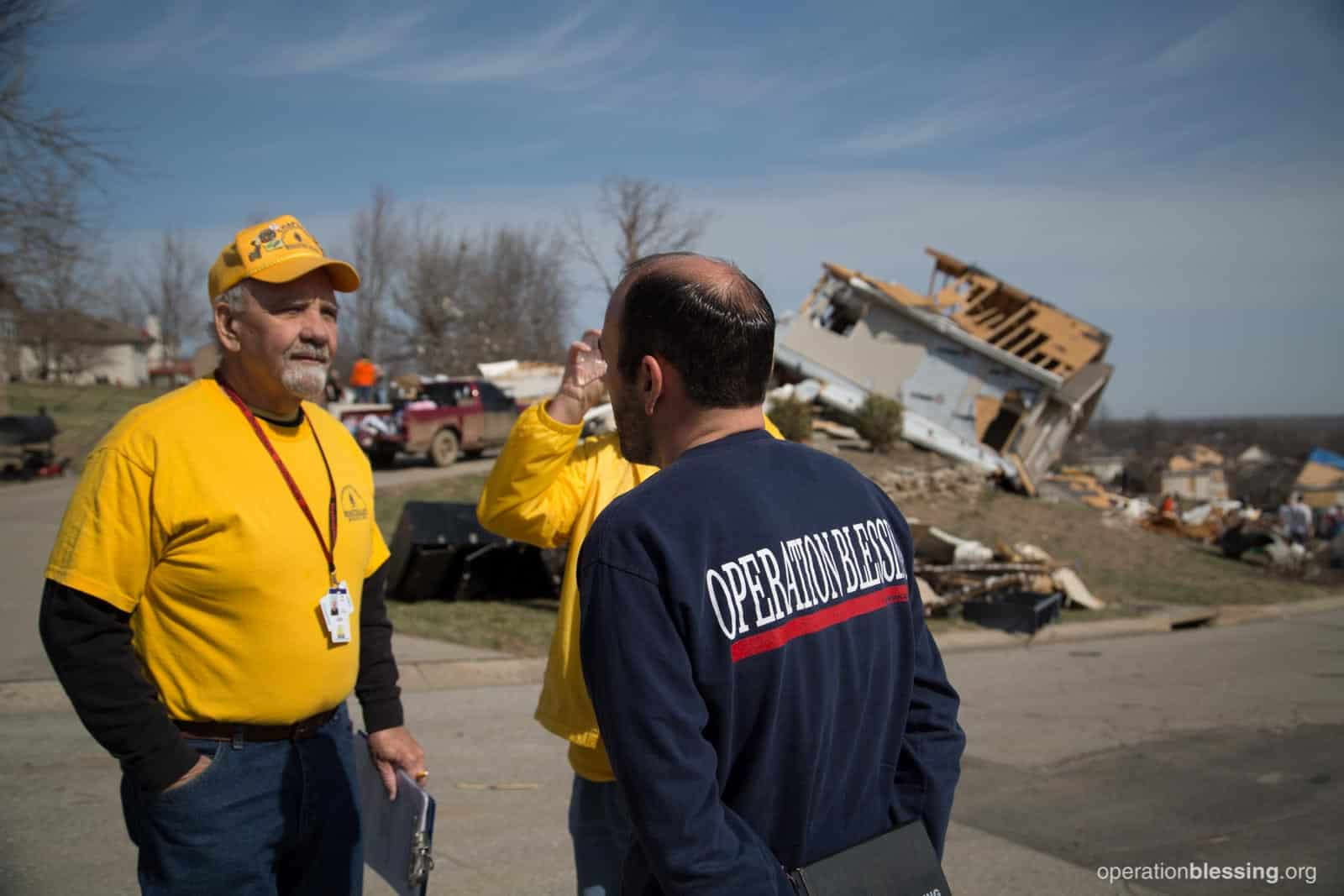 Operation Blessing's U.S. disaster relief team surveys the damage after a powerful tornado impacted the community of Oak Grove, Missouri.