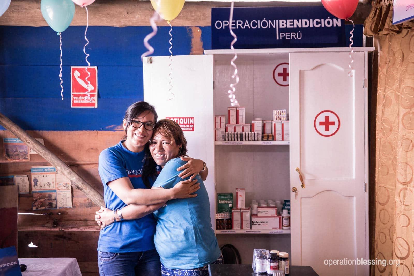Lizeth hugging an Operation Blessing staff member.