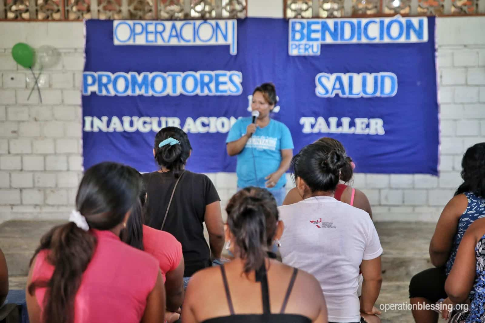 As a Community Health Worker, Lizeth speaks to a room full of people.