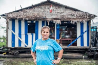 Lizeth stands wearing her Operation Blessing shirt, ready to help.