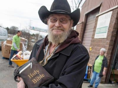 Vietnam veteran James poses with his Bible.