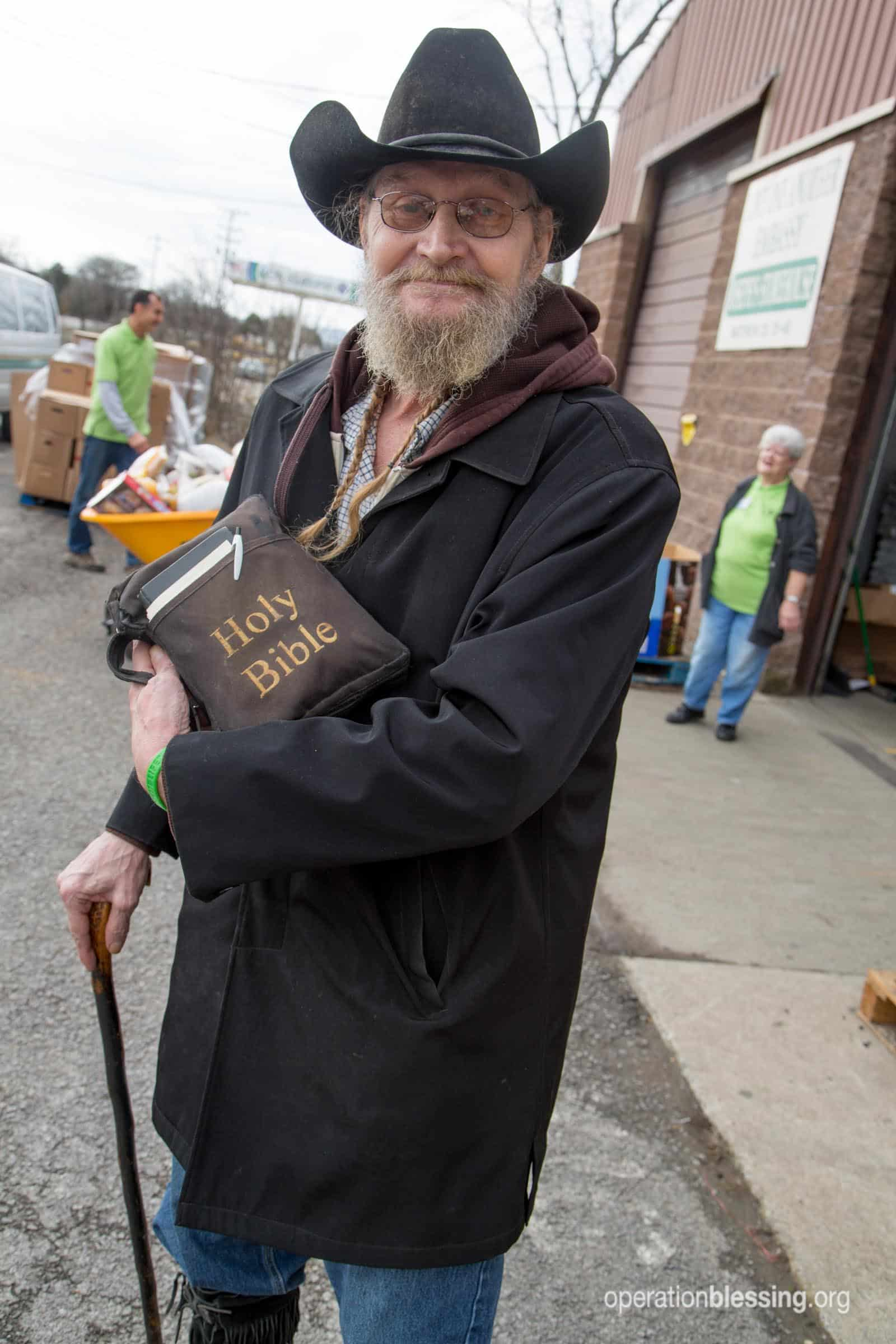 James, a Vietnam veteran, stands with his Bible at Joseph's Storehouse.