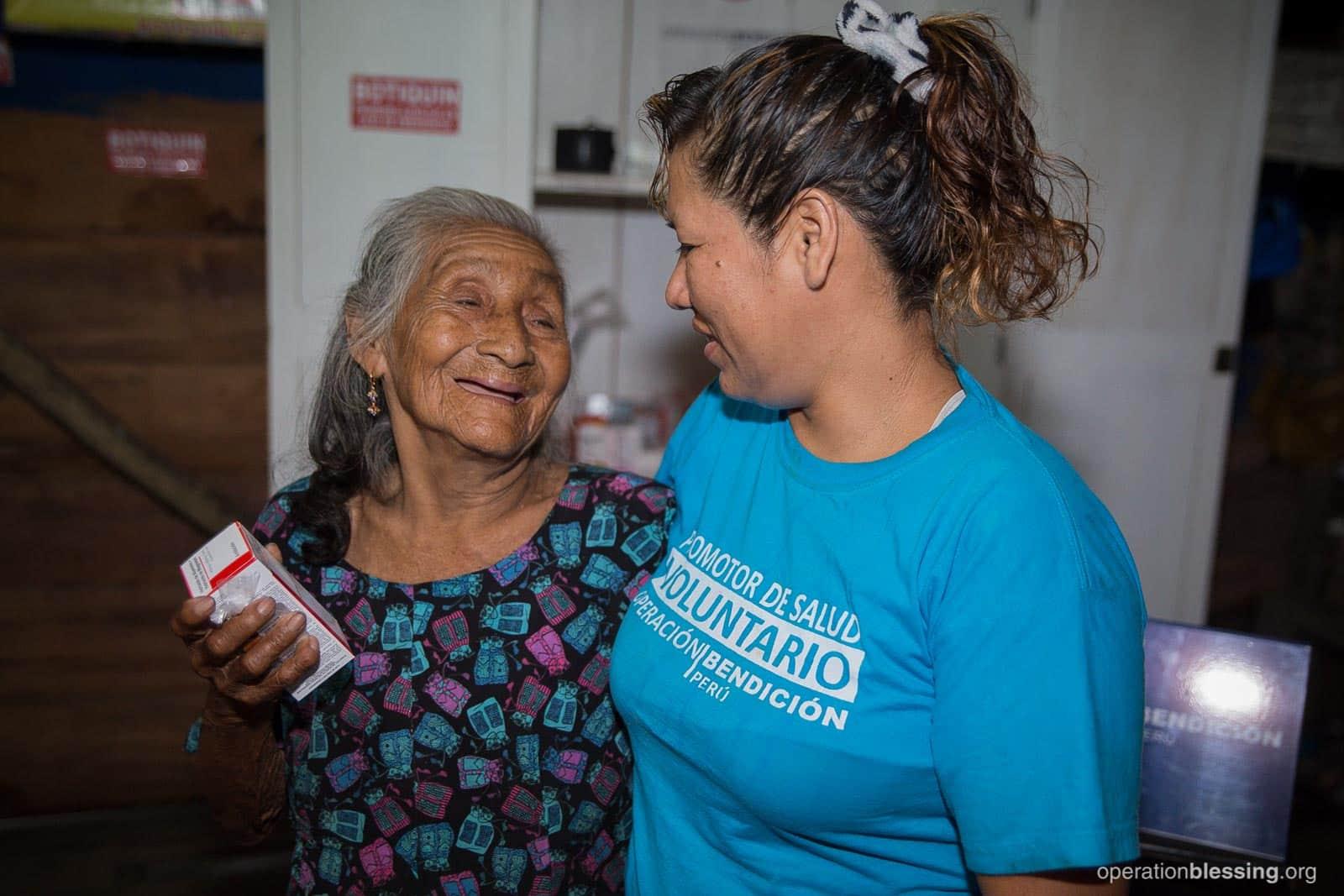 Lizeth helps her neighbor with medication and a hug.