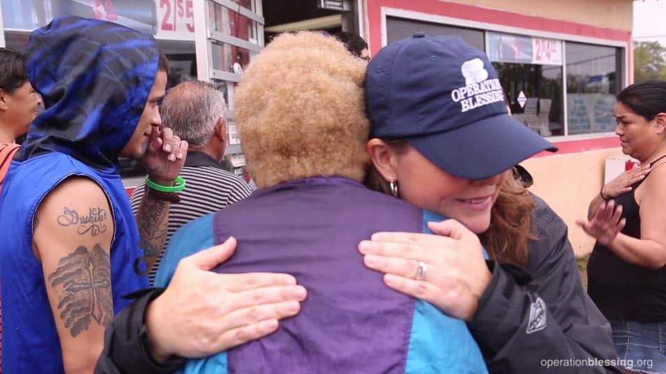 Jody Gettys, OB's Vice President of U.S. Disaster Relief, offers hugs and encouragement to those devastated by Hurricane Harvey.