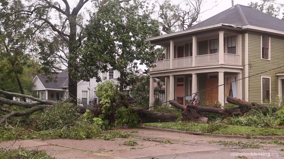 Hurricane Harvey hit land as a category 4 storm in Texas, causing significant damage, like this fallen tree.