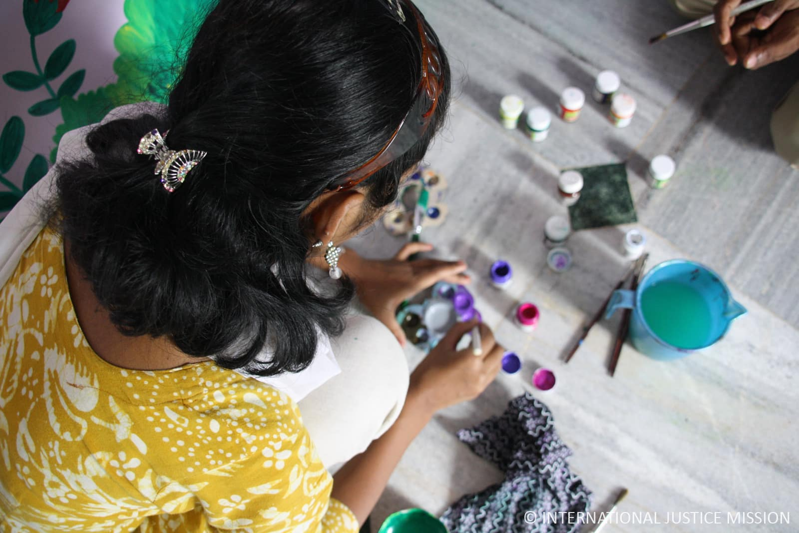 Naseen paints as part of her after-care once she is free from human trafficking.