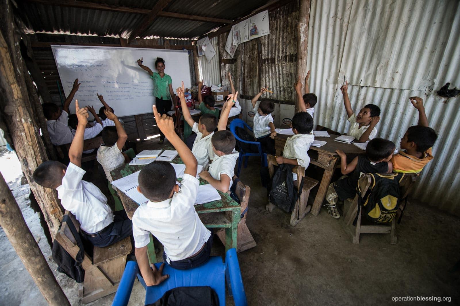 Children in this makeshift Honduran classroom endured intense heat, insects, and rain leaks.