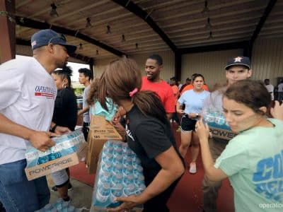 Volunteers work hard delivering supplies that will be used for helping Hurricane Harvey victims in Texas.