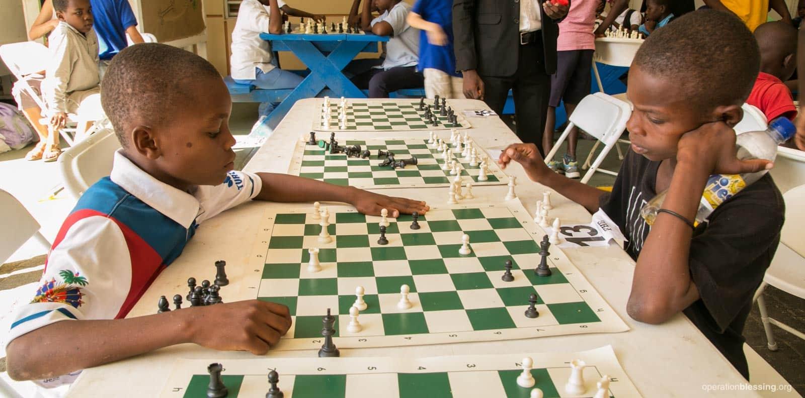 Haitian children learn self-discipline through Operation Blessing's chess program.