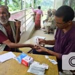 An elderly man receives medial care at a health camp sponsored by Operation Blessing and Revive Team Nepal.