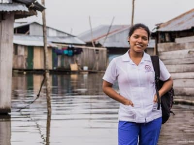 Linner from Belén, one of the poorest parts of Iquitos, proudly wears her uniform for nursing school.