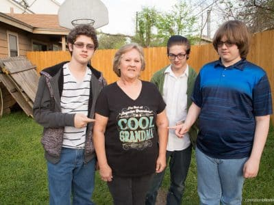As Cathy's shirt says, she is one cool grandma. She adopted the three special needs grandsons surrounding her as her own.