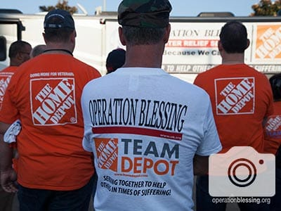 Volunteers of The Home Depot and Operation Blessing stand together, ready to team up to help hurricane victims.